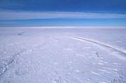 Alaska. North Slope, Arctic Ocean Sea ice road provides winter access for exploration and remote oil developments.
