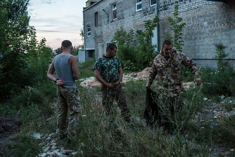 AVDIIVKA, UKRAINE - JULY 9, 2016: Ukrainian soldiers at dusk in Avdiivka, Ukraine. The town is now one of the most active areas of fighting along the line of control between the Ukrainian government and Russian-backed rebels. CREDIT: Brendan Hoffman for The New York Times