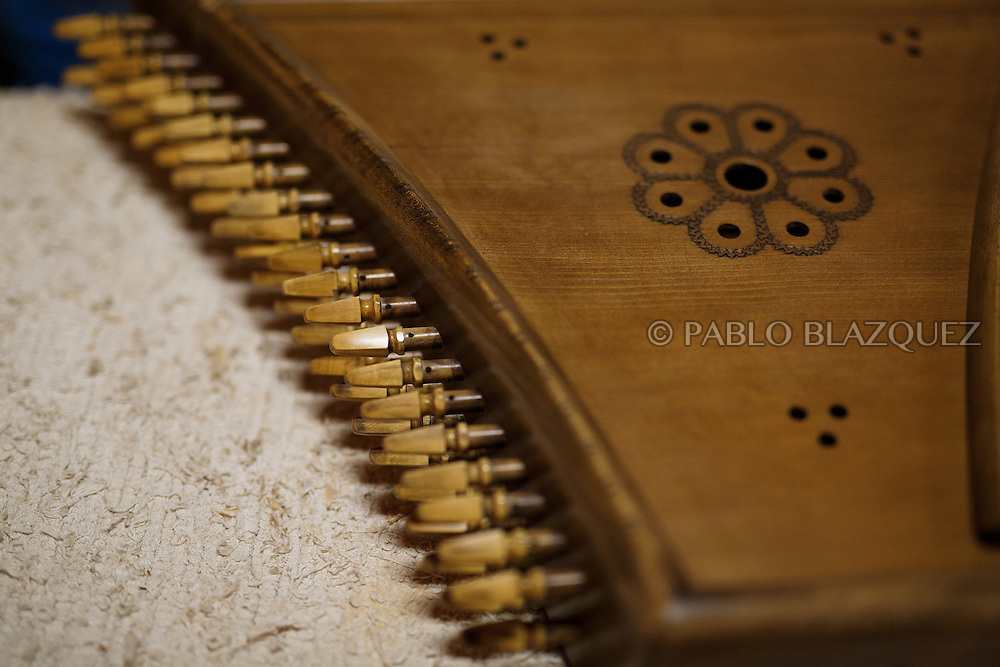 10/08/2016. A detail of a Pslatery which luthier Carlos Paniagua is working on in a workshop on August 10, 2016 in Pelayos de la Presa, Madrid province, Spain. The Collegiate of Santa María la Mayor is a Romanesque architecture church built during the 12th and 13th centuries. Recents restorations of the Church discovered many details on its sculptures, and luthiers found the opportunity of recovering and to reproduce instruments showing on its North gate. (© Pablo Blazquez)