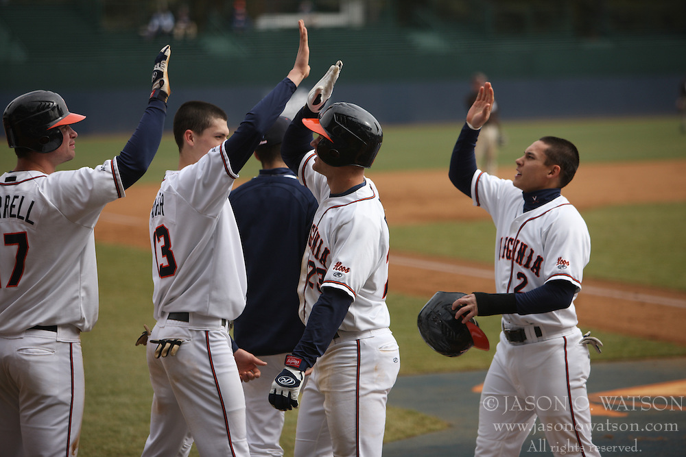 Virginia Cavaliers INF David Adams (23) is greeted by his teammates after hitting one of his two homeruns against Lehigh.  The #17 ranked Virginia Cavaliers baseball team defeated the Lehigh Mountain Hawks 12-1 at the University of Virginia's Davenport Field in Charlottesville, VA on February 24, 2008.