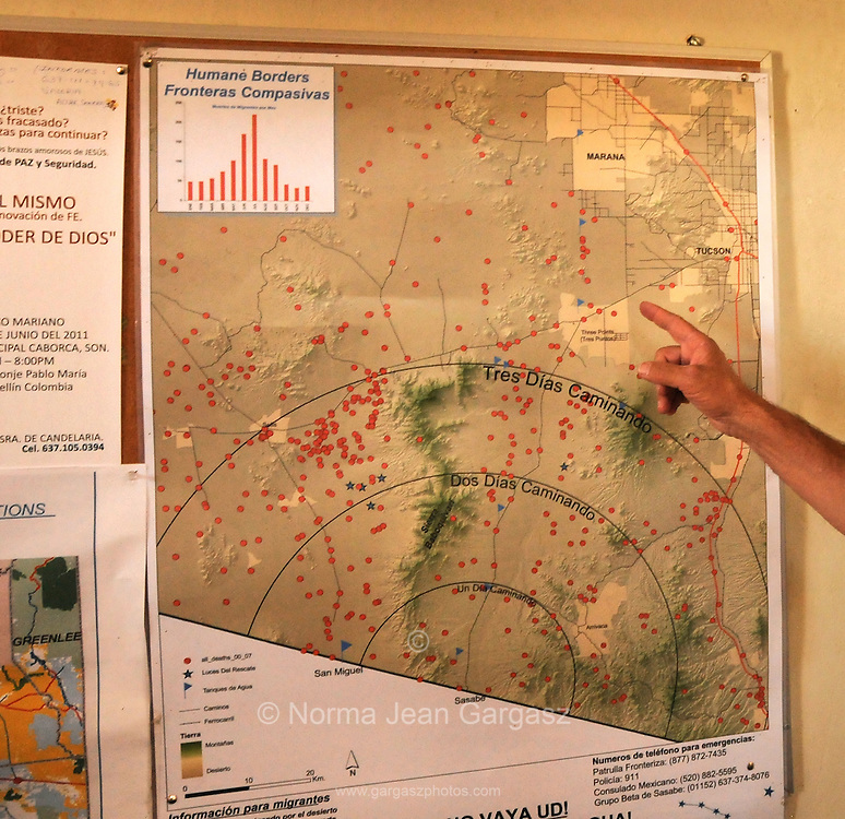 Rev. Robin Hoover refers to a map indicating the deaths of border crossers in the Arizona, USA, desert. The map hangs in a church frequented by migrants in Altar, Sonora, Mexico.