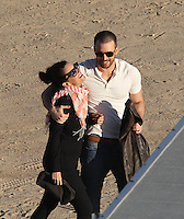 "February 01, 2012 Santa Clarita, CA.***EXCLUSIVE*** Chris Evans, the hunky star of ""Captain America"" & ""The Avengers"" shoots a sexy photo shoot for Details Magazine at Vasquez Rocks Park outside of Los Angeles. A bizarre show of public affection took place between Chris Evans and 3 different women working on set. Chris was seen heavily flirting, hugging, kissing and even groping all 3 women whom all seemed very happy and friendly with Chris. The 3 women in question was his Make-Up Artist, his Wardrobe Dresser and a woman who interviewed Chris on camera after the photo shoot . Photo by Eric Ford/On Location News 1/818-613-3955 info@onlocationnews.com"