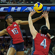 Foluke Akinradewo hits in the exhibition match between the USA and Bulgaria at the Galen Center, Los Angeles, Calif., Wed., July 18, 2012.