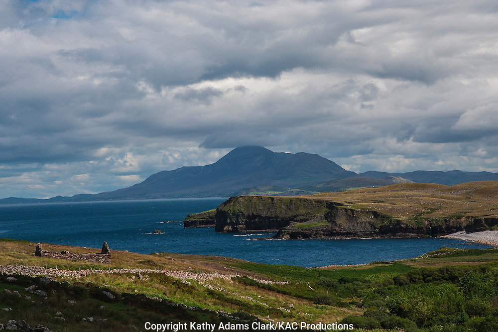 Coastline of Clare Island with View of Crough Patrick on western Ireland mainland.