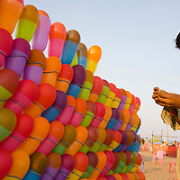 Balloon seller on Chennai's main beach. Chennai is the third largest commercial and industrial centre in India. It is considered to be the automobile capital of India, with a major percentage of the country?s automobile industry having a base in the city. Chennai is the second-largest exporter of IT services in India, behind Bangalore and is a base for the manufacture of hardware and electronics, with many multinational corporations setting up plants in its outskirts. The city faces problems with water shortages, traffic congestion and air pollution.