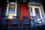 Image of rocking chairs on a porch in downtown Stowe, Vermont, American Northeast