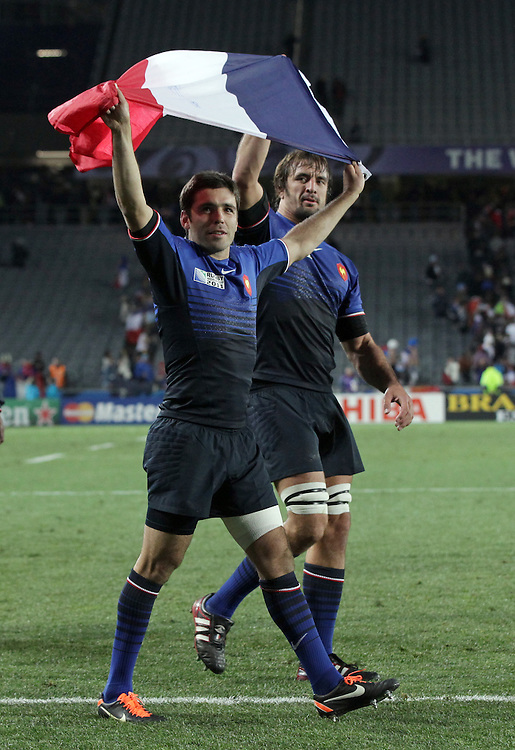 France's Dimitri Yachvili, left, and Julien Pierre celebrate defeating England in quarter-final 2 match of the Rugby World Cup 2011, Eden Park, Auckland, New Zealand, Saturday, October 08, 2011.  Credit:SNPA / David Rowland