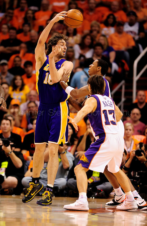 May 29, 2010; Phoenix, AZ, USA; Los Angeles Lakers forward Pau Gasol (16) makes a pass over Phoenix Suns center Channing Frye (8) during the first quarter in game six of the western conference finals in the 2010 NBA Playoffs at US Airways Center.  The Lakers defeated the Suns 111-103.  Mandatory Credit: Jennifer Stewart-US PRESSWIRE