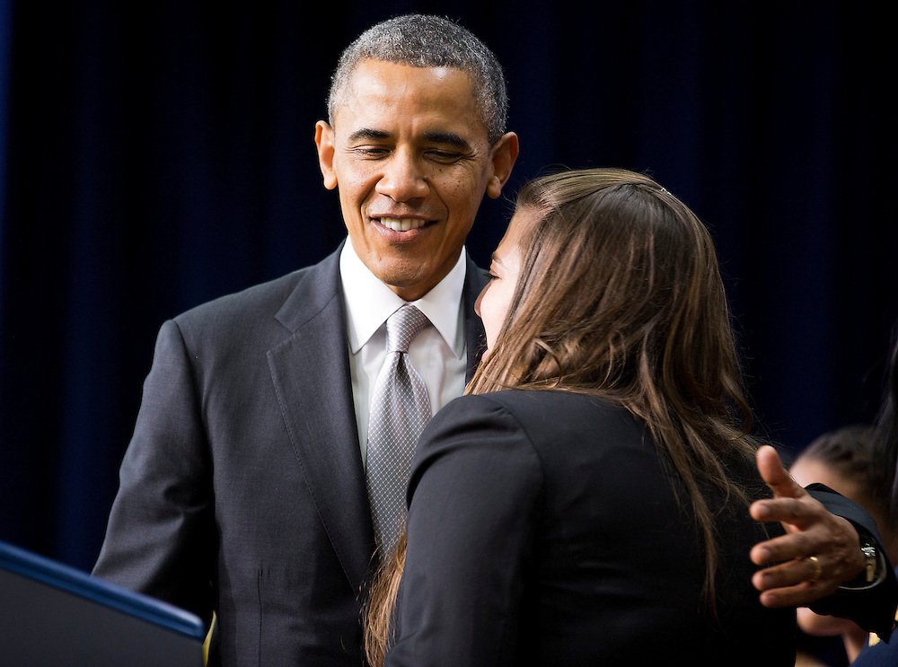 U.S. President Barack Obama hugs Monica Weeks before speaking about the Affordable Care Act at the White House in Washington December 3, 2013. President Barack Obama's chief of staff said on Tuesday that more than 1 million new visitors had checked out the HealthCare.gov website on Monday, the first day after a major overhaul of the troubled site used to shop for health insurance required under new reforms.  REUTERS/Joshua Roberts    (UNITED STATES)