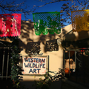SHOT 12/26/2007 - The Art Tafoya Gallery in Old Town Albuquerque bathed in late afternoon light. The area is a historic district in Albuquerque, New Mexico, dating back to the founding of the city by the Spanish in 1706. Today it is a popular shopping and tourist destination. Old Town comprises about ten blocks of historic adobe buildings grouped around a central plaza (a common feature of Spanish colonial towns). Many of the buildings in Old Town are houses that have been converted into restaurants and small art and souvenir shops. Albuquerque is the largest city in the state of New Mexico, United States. It is the county seat of Bernalillo County and is situated in the central part of the state, straddling the Rio Grande. The city population was 448,607 as of the 2000 U.S. census. As of the 2006 census estimate, the city's population was 504,949, with a metropolitan population of 816,811 as of July 1, 2006. In 2006, Albuquerque ranked as the 33rd-largest city and 61st-largest metropolitan area in the U.S. Albuquerque is home to the University of New Mexico (UNM) and Kirtland Air Force Base as well as Sandia National Laboratories and Petroglyph National Monument. The Sandia Mountains run along the eastern side of Albuquerque and the Rio Grande flows through the city north to south..(Photo by Marc Piscotty/ © 2007)