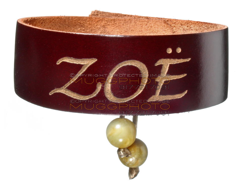 leather name bracelet that reads zoe with yellow rock charms