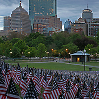 Boston photography from New England based fine art photographer Juergen Roth showing the Garden of American Flags in the Boston Common on Memorial Day 2014. The Military Heroes Garden of American flags in Boston Common displays nearly 37000 American flags, each flag represents the lost life of a fallen service member from Massachusetts since the Revolutionary War (1775 to 1783) to the present in 2014. Visitors are reminded of the essence of the Memorial Day holiday through this deeply moving site.<br />