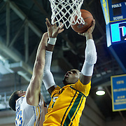 Delaware Forward Carl Baptiste (33) battles George Mason Forward Jonathan Arledge (5) for the loose ball in the first half of a regular season NCAA basketball game against George Mason Saturday, March 2, 2013 at the Bob Carpenter Center in Newark Delaware.