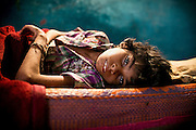 Aadite, 10, a boy suffering from spastic microcephaly, cerebral palsy and malnutrition, is laying motionless on a bed inside his home in Kabit Pura, near the abandoned Union Carbide (now DOW Chemical) industrial complex in Bhopal, Madhya Pradesh, central India. Aadite's father, Raju, a '1984 Gas Survivor', died in March 2013 at the age of 32, due to lungs failure. Because of his mother's need to act as the family's breadwinner, Aadite cannot attend the programs 'Chingari Trust Rehabilitation Centre', one of two vital medical institutions funded by 'The Bhopal Medical Appeal'. He lives his days inside a small room he occupies with his mother, Lakshmi, 30, who works six days a week as a cleaner, his two sisters Mayuri, 12, Mahag, 7, and his younger brother Anuj, 5. None of his siblings are attending school or any kind of practical education.