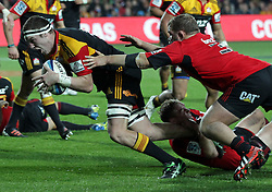 Chiefs' Brodie Retallick beats Crusaders' Owen Franks to score a try in a Super Rugby match, Waikato Stadium, Hamilton, New Zealand, Friday, July 06, 2012.  Credit:SNPA / David Rowland