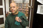"""Woodbourne Correctional Facility inmate and Bard College student Jimmy Vasquez in front of the library at Woodbourne Correctional Facility. ..Story: The Bard Prison Initiative.Former inmate Carlos Rosario, 35-year-old husband and father of four, was released from Woodbourne Correctional Facility after serving more than 12 years for armed robbery. Rosado is one of the students participating in the Bard Prison Initiative, a privately-funded program that offers inmates at five New York State prisons the opportunity to work toward a college degree from Bard College. The program, which is the brainchild of alumnus Max Kenner, is competitive, accepting only 15 new students at each facility every other year. .Carlos Rosario received the Bachelor of Arts degree in social studies from the prestigious College Saturday, just a few days after his release. He had been working on it for the last six years. His senior thesis was titled """"The Diet of Punishment: Prison Food and Penal Practice in the Post-Rehabilitative Era,"""".Rosado is credited with developing a garden in one of the few green spaces inside the otherwise cement-heavy prison. In the two years since the garden's foundation, it has provided some of the only access the prison's 800 inmates have to fresh vegetables and fruit...Rosario now works for a recycling company in Poughkeepsie, N.Y...Photo © Stefan Falke"""