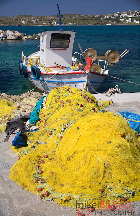 nets and boat on harbour.<br /> Parikia village. Paros island, Cyclades islands, Aegean Sea, Greece, Europe