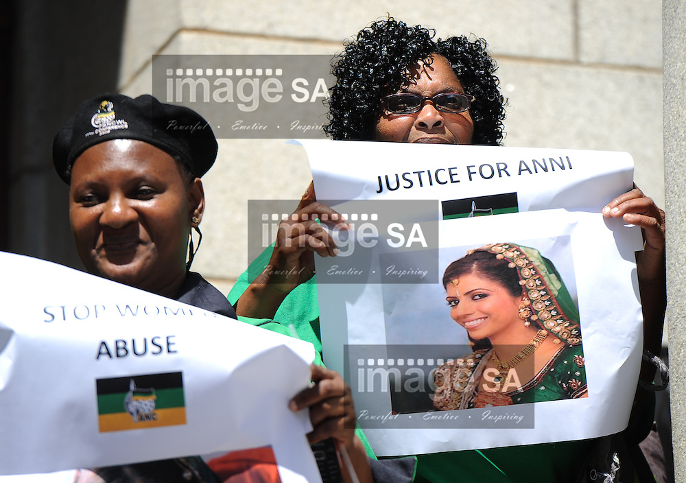 CAPE TOWN, SOUTH AFRICA - Monday 6 October 2014, Nondumiso Faxa of the African National Congress (ANC) Womens League holds up posters of Anni Dewani highlighting women abuse during Day 1 of the Shrien Dewani trial at the Cape High Court before Judge Jeanette Traverso. Dewani is caused of hiring hit men to murder his wife, Anni. Anni Ninna Dewani (n&eacute;e Hindocha; 12 March 1982 &ndash; 13 November 2010) was a Swedish woman who, while on her honeymoon in South Africa, was kidnapped and then murdered in Gugulethu township near Cape Town on 13 November 2010 (wikipedia).<br /> Photo by Roger Sedres