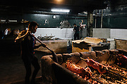 Pigs are roasted and prepped for delivery at Elarz Lechon in Quezon City, Metro Manila, Philippines. During the height of the season, they cook 200-400 pigs a day providing to hotels and fiestas. The leftovers from the lechon is cooked in vinegar and called paksiw na lechon. The vinegar adds a sour flavor and preserves the meat.