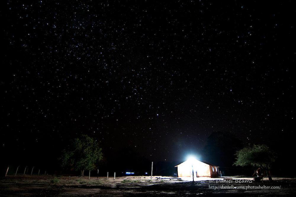 Lighted Baptist church and night sky in Yapiroa, Charagua, Santa Cruz, Bolivia