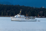 The fishing charter yacht M.V. Edgewater Fortune anchored in Vancouver's English Bay.  Photographed from Kitsilano Beach Park in Vancouver, British Columbia, Canada.
