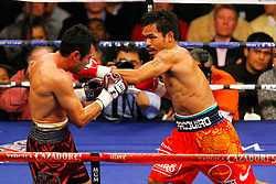 December 6, 2008: Oscar De La Hoya (Maroon) and Manny Pacquiao (Orange) trade punches during their 12 round welterweight bout at the MGM Grand Garden Arena in Las Vegas, NV.  No Usage/Sales Permitted PHOTO: Ed Mulholland/HBO