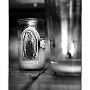 SHOT 11/16/11 12:34:09 PM - A roadside capilla featuring a candle with Our Lady of Guadalupe along Carretera Federal 180D near Valladolid, Mexico. Roadside capillas, or tiny chapels, in the Mexican state of Quintana Roo. The capillas are common along the roads and highways of Mexico which is heavily Catholic and are often dedicated to certain patron saints or to the memory of a loved one that has passed away. Often times they contain prayer candles, pictures, personal artifacts or notes. (Photo by Marc Piscotty / © 2011)