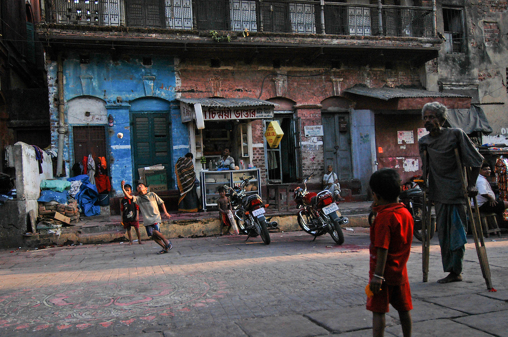 Children warm up for a game of cricket. Kolkata, India. 3/18/2006 Photo by Ben Depp