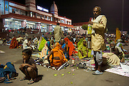 Hundreds of travellers camp out in front of the station entrance, waiting for their train.
