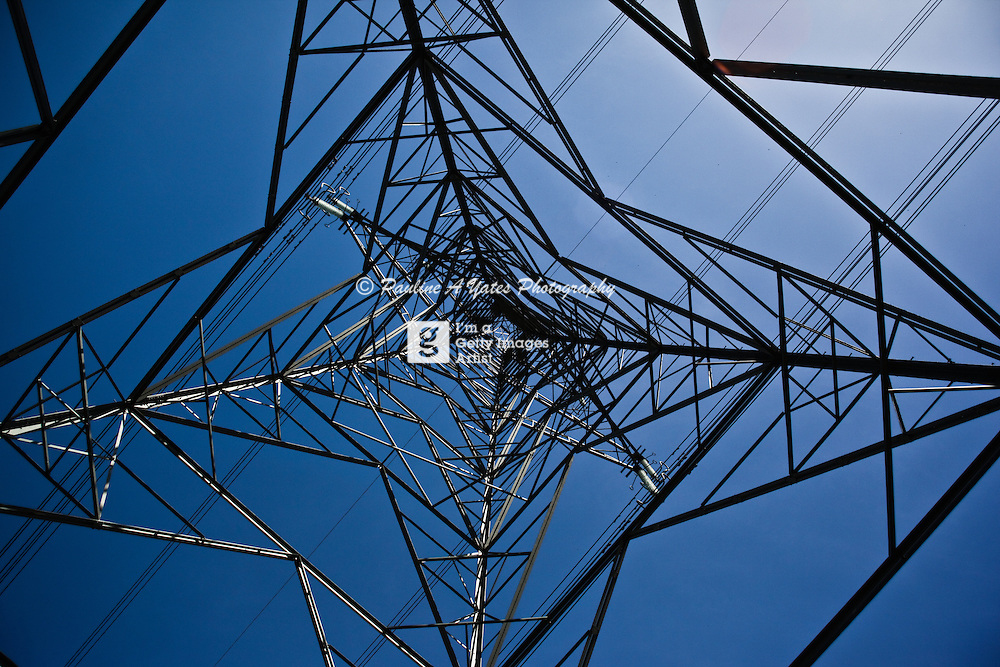 Looking up through a pylon on a clear blue summer's day gives an abstract image.