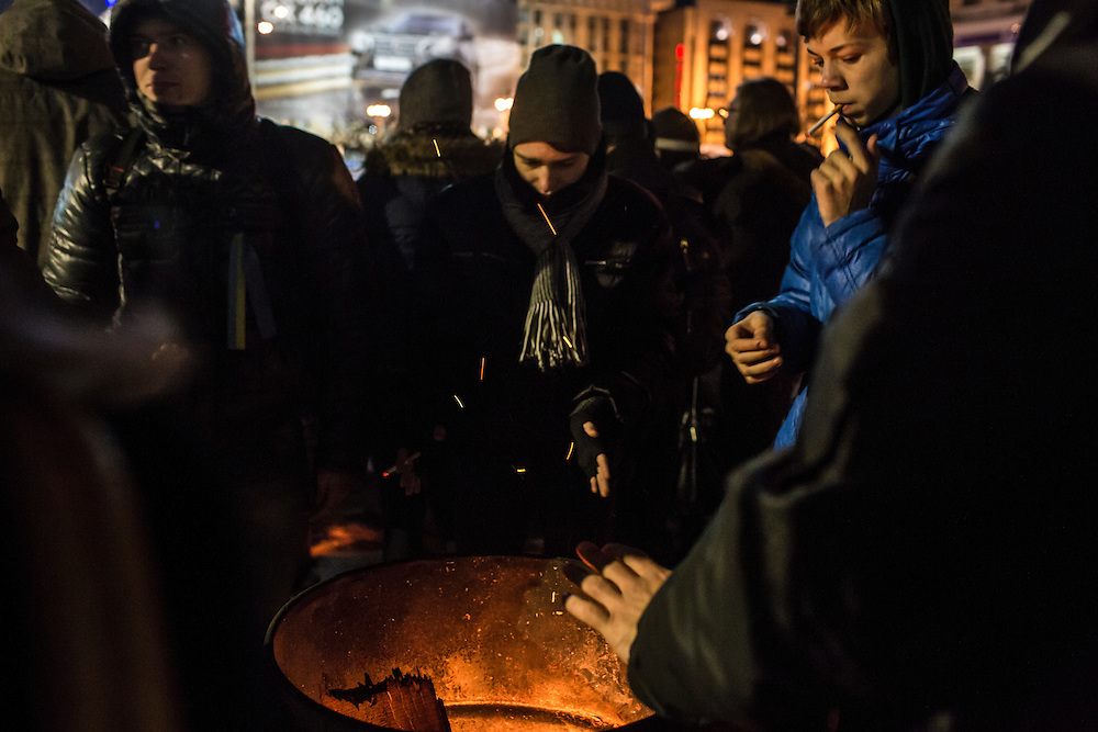 KIEV, UKRAINE - DECEMBER 3: Protesters warm themselves by a fire during an ongoing anti-government rally in Independence Square on December 3, 2013 in Kiev, Ukraine. (Photo by Brendan Hoffman/Getty Images)