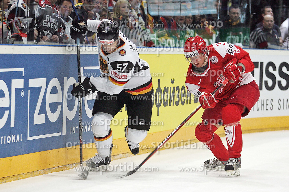 12.05.2010, Lanxess Arena, Koeln, GER, 74. IIHF WM, Gruppe D, Daenemark ( DEN ) vs Deutschland ( GER ) im Bild: Marcel GOC ( GER / Nashville #57 ) / Philip LARSEN ( DEN #3 / Gothenburg )  EXPA Pictures © 2010, PhotoCredit: EXPA/ nph/   Florian Mueller / SPORTIDA PHOTO AGENCY