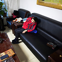 Beijing, March 11 : Tian Peng, 15, is lying on the sofa while his mother Cui Xinying works in the kitchen.<br /> As a baby Tian Peng fell ill with brain   hemorrhage supposedly due to a lack of vitamin K. When Tian Peng was a kid, friends advised the parents to simply abandon him as there's neither enough help nor support in China apart from a small NGO. Tian is unable to speak, think, walk and needs help for everything.<br /> Chinese attitudes towards people with disabilities have improved in recent years, but the support of society and opportunities in education and employment are scarce.