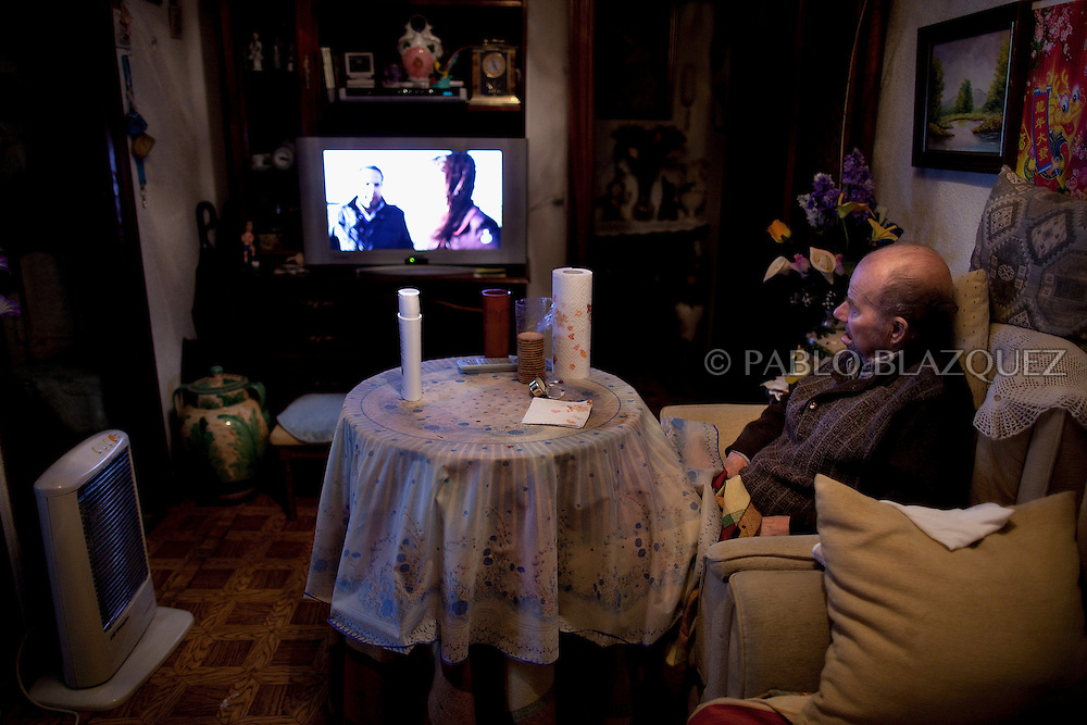 Vicente watches television at his home in Madrid, on April 15 2012. Spanish Vicente Torres, 73, who is severely ill and underwent a recent heart surgery, and is waiting for a thrombus surgery faces an eviction from his house next April 18th after he endorsed his son, so Citibank would concede a credit to buy a house. His son already handed his house to the bank. Torres has lived at his home for the last 55 years and was paying it for 30 years. Eviction procedures in Spanish courts for unpaid mortgages and rent hit a record of 58,241 in 2011, a 21.2 percent rise over the previous year. Evictions have soared in Spain since the collapse of a property bubble in 2008 that triggered the country's economic crisis.