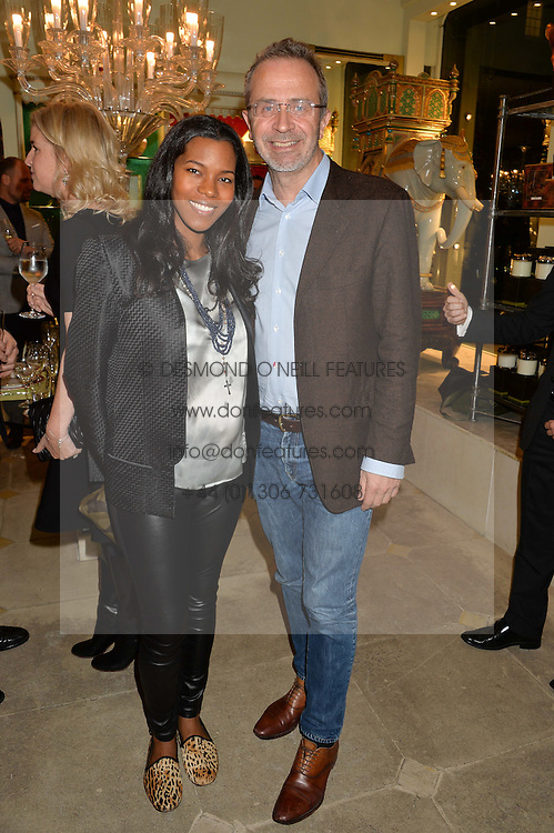 ASHLEY SHAW-SCOTT wife of architect David Adjaye and PETER WHEELER at the London debut of Nest - an organisation to promote peace and prosperity in partnership with artisans worldwide, held at Thomas Goode & Co, South Audley Street, London on 4th November 2014.