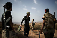 LIBYAN ARAB JAMAHIRIYA, Gualish : A Libyan rebel fighter carring ammunitions on the front line by near the southwest desert hamlet of Gualish as rebels repel an attack from forces loyal to Moamer Kadhafi aimed at capturing the city on July 24, 2011.ALESSIO ROMENZI