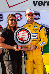 FONTANA, CA - JUNE 26 Tonya Primavera of Verizon presents the Verizon Award to Simon Pagenaud of France, driver of the #22 Penske Truck Rental Dallara Chevrolet after earning pole position during qualifying for the Verizon IndyCar Series MAVTV 500 IndyCar Race at the Auto Club Speedway on June 26, 2015 in Fontana, California. Simon Pagenaud earned his second career Indy car pole and first on an oval in leading a Team Penske sweep of the front row for the MAVTV 500 with a two-lap average speed of 218.952 mph on the 2-mile Auto Club Speedway. 2015 June 26. Byline, credit, TV usage, web usage or linkback must read SILVEXPHOTO.COM. Failure to byline correctly will incur double the agreed fee. Tel: +1 714 504 6870.