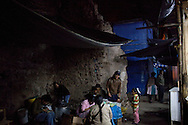 People eat dinner in a corner of the market on Wednesday, Apr. 15, 2009 in Ayacucho, Peru.
