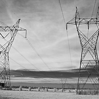 High voltage electrical power lines surrounded by a horse pasture in rural Kentucky.  Infrared (IR) photograph by fine art photographer Michael Kloth.