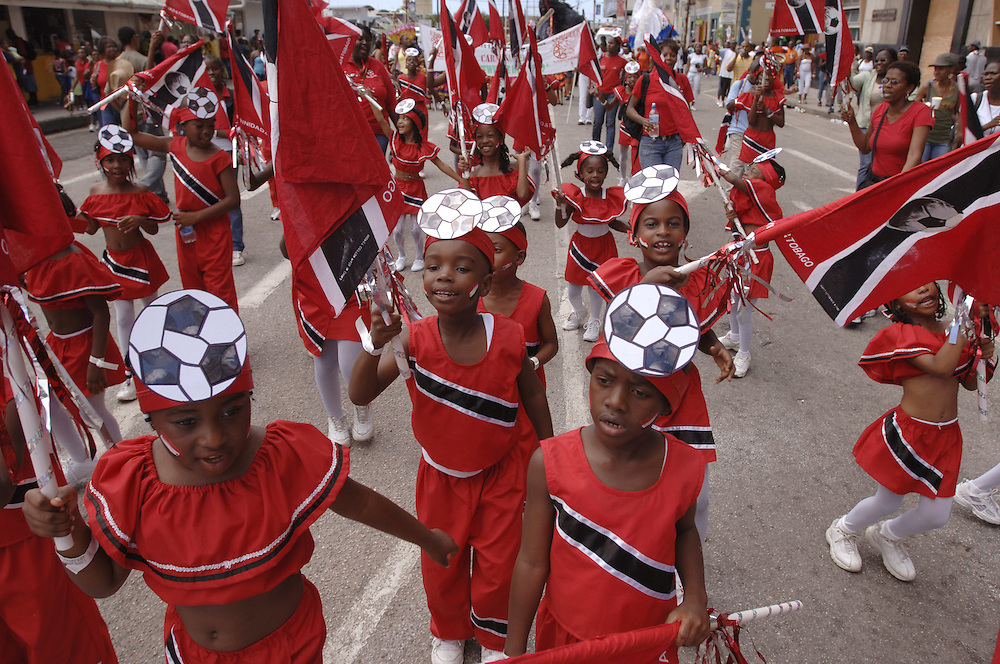 West Indies, Caribbean Carnival 2006, costumes, national colours red black white, sports, festival, dance, fun, the St. Dominik's Children's Home formed a carnival band called 'Soca Warriors' after their National Football Team. Here they dance in the streets of Port of Spain a week before the real Carnival beginns at a children's carnival in support for their team's participation in the World Cup Games in Germany .German: Trinidad und Tobago, Port of Spain, Karibik, Karneval 2006, Fussball, WM, Sport, Rot Schwarz Weiss National Farben Kostueme Feste Kultur, Feiern, Tanzen, Spass, Kinder und Jugendliche des St. Dominik Waisenhauses ziehen im Kinderkarneval als 'Soca Warriors' verkleidet durch die Strassen von Port of Spain, um ihre Fussballnationalmannschaft, die 'Soca Warriors', vor der Teilnahme an der Fussballweltmeisterschaft in Deutschland zu unterstuetzen, eine Woche vor dem grossen Karneval Wochenende..
