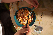 Chee cheong fun, steamed rice flour sheets tossed with chili sauce and served with pickled chili. Ipoh, Malaysia