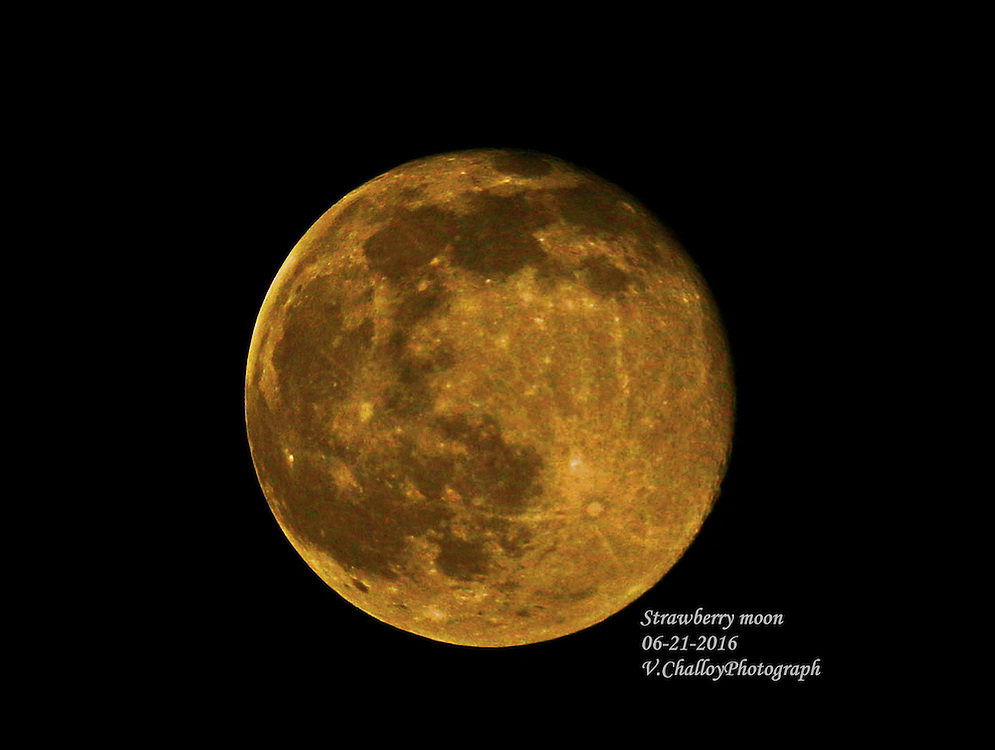 Strawberry Moon by Vangeline Challoy<br /> <br /> Vangeline Challoy is from the Philippines. She is an amateur photography and loves nature very much. Most of her photos are pictures of sunset, nature, people, moon and night scenes.