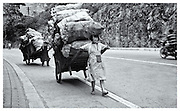 Girl with cart, China 1999.