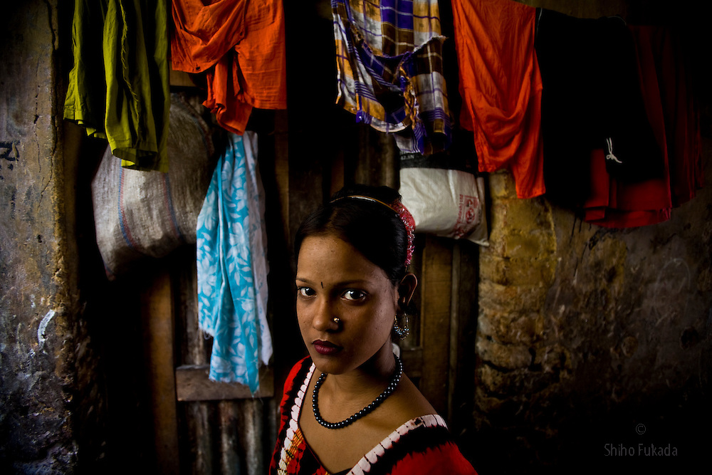 A young sex worker is seen at brothel, June 2, 2007 in Mymensingh, Bangladesh. <br /> The majority of the 20,000 to 30,000 female sex workers in Bangladesh are victims of trafficking. <br /> Once they enter the brothel, usually before the age of 12, they are generally in for life because of social stigma and poverty.