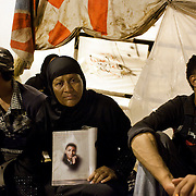 Egyptian mother Na´a Said holds a photo of her son, Arafat Ahmed Mohammed, who was killed during the Egyptian revolution, as she and others stage a sit-in outside a tent on the eve of a large protest in Tahrir Square in downtown Cairo, Egypt July 7, 2011. Many of the protesters have vowed to stay in the square until the demands of the revolution are met, including an end to military trials of civilians, prosecution of police officers accused of murder or torture and open trials of former regime officials including ex-President Hosni Mubarak. (Photo by Scott Nelson/Der Spiegel)