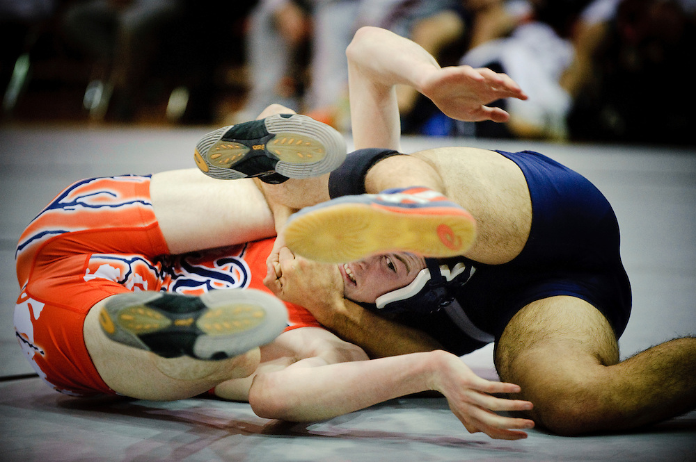 (staff photo by Matt Roth)<br /> <br /> Reservoir's Nick Hower, subdued by La Plata's Taylor Sims, would only last 3:02. Hower was one of only two Gators pinned during the 3A/4A State Duals championships, a fact that would prove favorable when the last match ended in a tie. Reservior High School had three pins, which inched them atop La Plata 32-31 to win the 3A/4A State Duals Championships held at North County High School Tuesday, February 23, 2010.