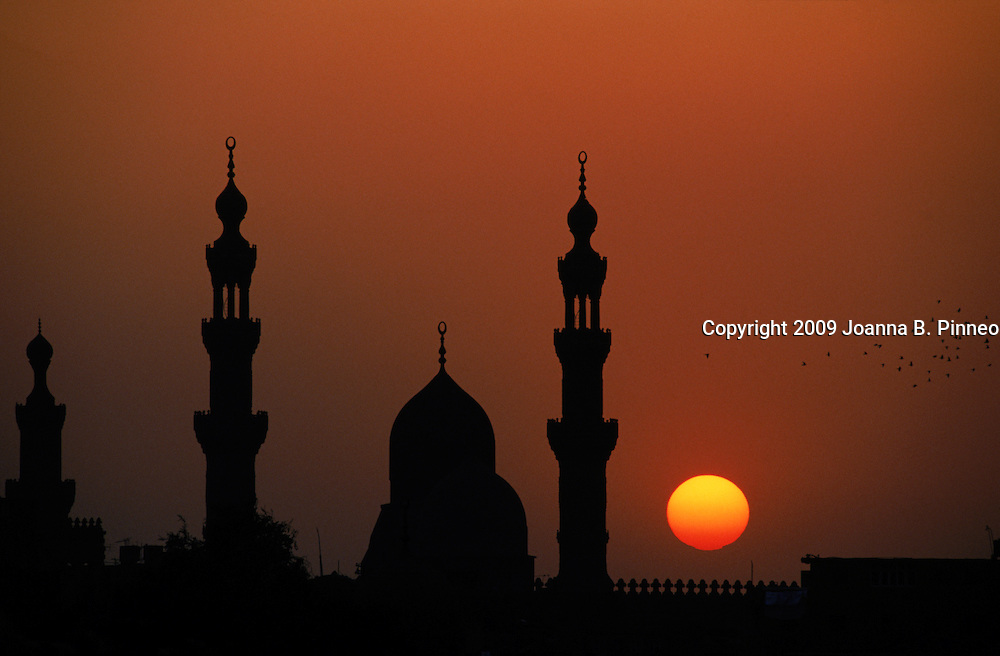 Mosque silhouette with minaret at sunset, Cairo, Egypt.    Aurora image #0150400701