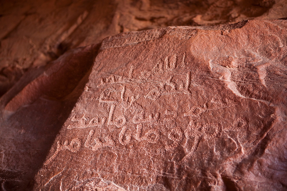 Nabatean petroglyph inscriptions in Khazali Canyon, Wadi Rum, Jordan.