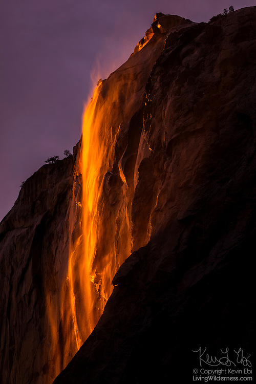 """Horsetail Fall, a 1,000-foot (305-meter) waterfall, appears like lava at sunset as it pours over the granite face of El Capitan in Yosemite National Park, California. The dramatic lighting effect, which has been called a """"firefall,"""" appears in mid-to-late February if the weather conditions are just right."""
