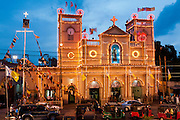 St. Anthony's shrine in Kochchikade, Colombo with the harbour in the background. Illuminated for the annual feast and festival.